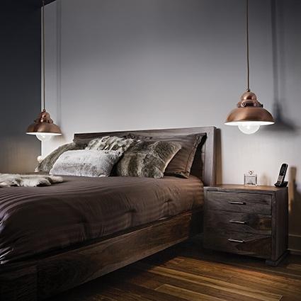 Modern interior design luxury bedroom with queen sized bed and wooden floor